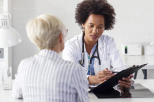 doctor talking with an elderly patient